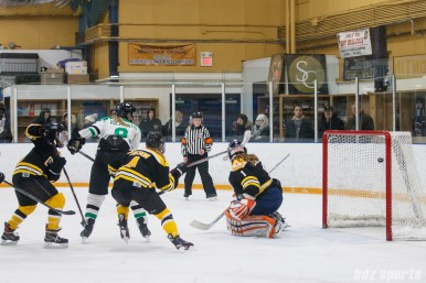 Markham Thunder forward Kristen Richards (9) flicks on the puck into the back of the net