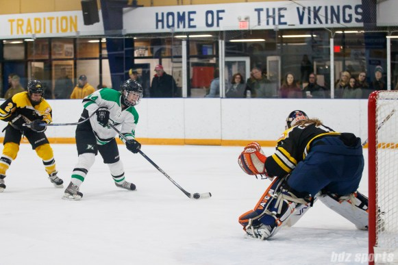 Markham Thunder defendner Kristen Barbara (24) takes on Boston Blades goalie Amanda Cariddi (1)
