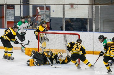 Boston Blades goalie Lauren Dahm (35) uses her stick to clear the puck