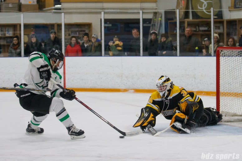 Markham Thunder forward Jamie Lee Rattray (26) on a breakaway against Boston Blades goalie Lauren Dahm (35)