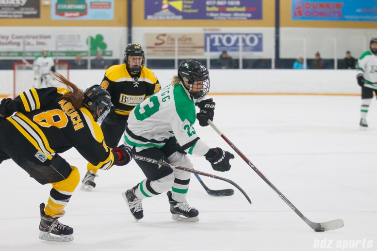 Markham Thunder defender Lindsay Grigg (23) looks to get past Boston Blades defender Sato Kikuchi (8)