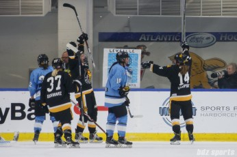 Boston Pride forward Jillian Dempsey (14) celebrates her goal with teammates Heather Schwarz (37) and Mary Parker (7)