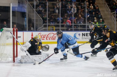 Boston Pride goalie Brittany Ott (29) and Buffalo Beauts forward Corinne Buie (23)