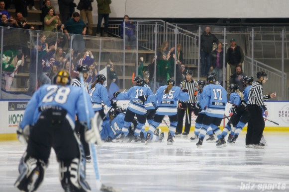 The Buffalo Beauts celebrate defender Sarah Casorso's (10) OT game-winning goal