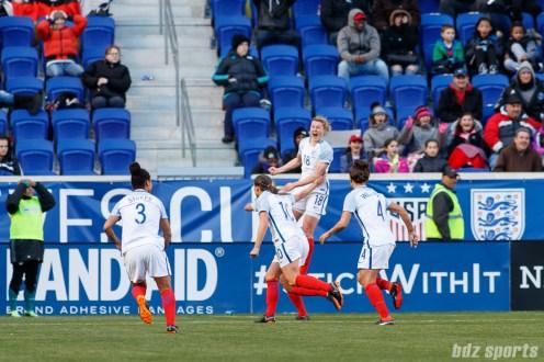Team England forward Ellen White (18) reacts after scoring the equalizer