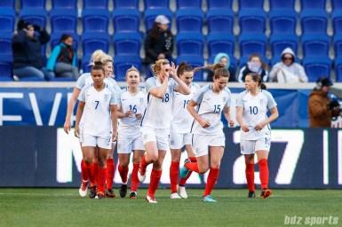 Team England forward Ellen White (18) celebrates her second goal of the game