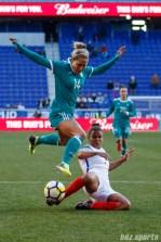 Team England defender Nikita Parris (7) slide tackles the ball away from Team Germany defender Anna Blasse (14)