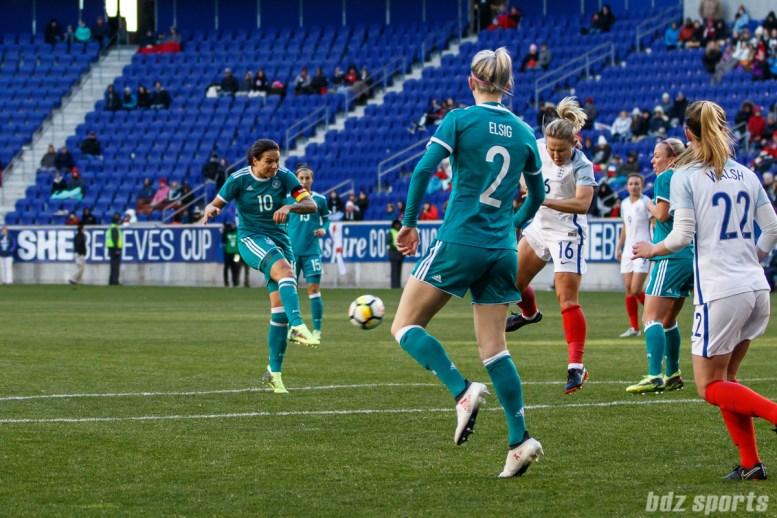 Team Germany midfielder Dzsenifer Marozsan (10) takes a shot on goal