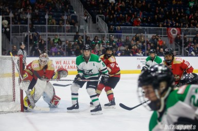 Kunlun Red Star players Noora Raty (41), Jessica Wong (49), and Rachel Llanes (91) and Markham Thunder forward Jenna McParland (91) keep an eye on the puck