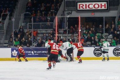 The Kunlun Red Star celebrate forward Kelli Stack's game-tying goal in the second period of the game