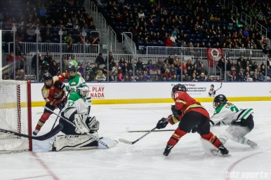 Kunlun Red Star forward Kelli Stack (16) takes a shot on Markham Thunder goalie Erica Howe (27)