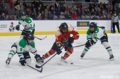 Markham Thunder players Laura Fortino (8) and Devon Skeats (21) defend against Kunlun Red Star forward Rachel Llanes (91)