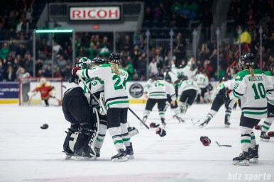 Markham Thunder players Erica Howe (27), Jocelyne Laroque (3), and Kristen Barbara (24) hug it out as the Thunder celebrate winning the 2018 Clarkson Cup Final in OT