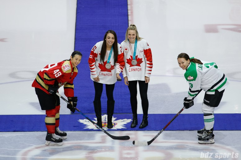 Kunlun Red Star forward Jessica Wong (49) and Markham Thunder defender Jocelyne Laroque (3) take the ceremonial face-off with Canadian National Team silver medalists Sarah Nurse (20) and Renata Fast (14)