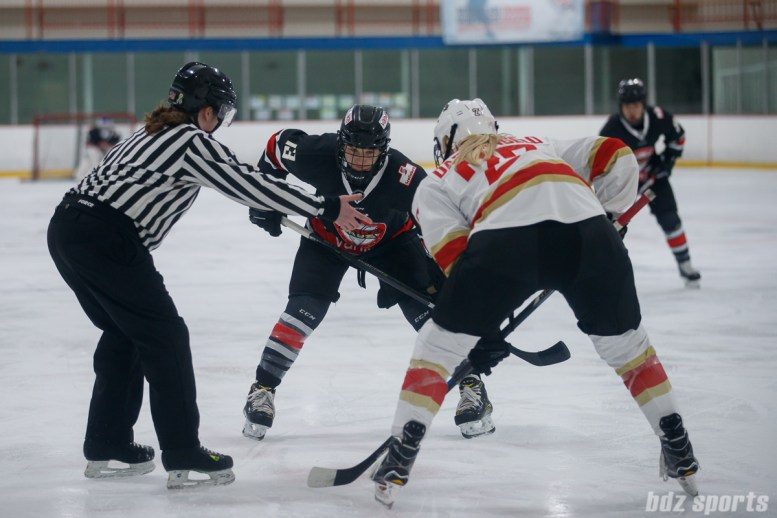 Vanke Rays defender Ashleigh Brykaliuk (13) and Kunlun Red Star forward Shiann Darkangelo (27) take a face-off