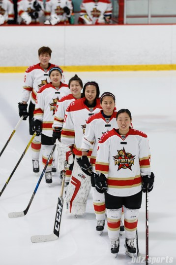 The Kunlun Red Star stand for the playing of the Chinese national anthem