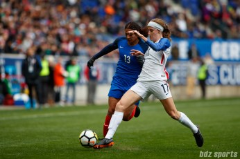 Team USA defender Tierna Davidson (17) challenges Team France forward Valerie Gauvin (13) for the ball