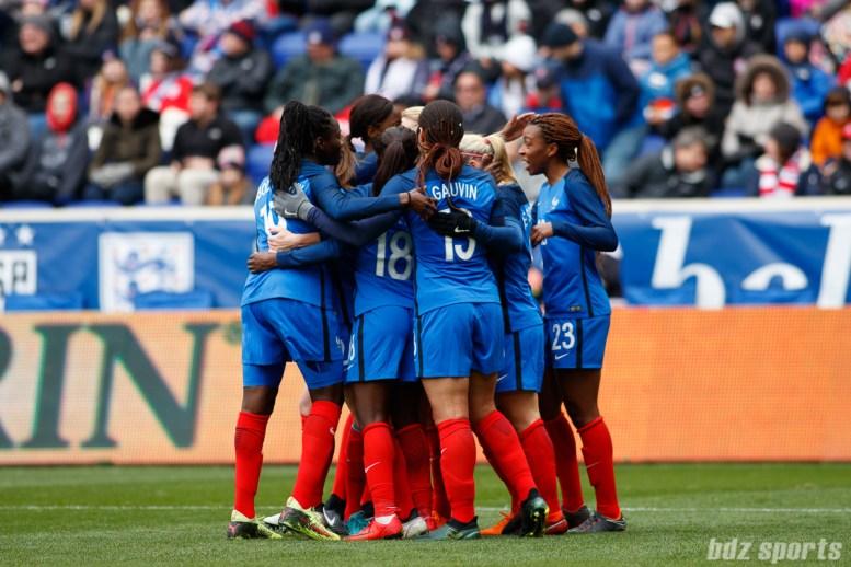 Team France celebrates forward Eugenie Le Sommer's (9) goal
