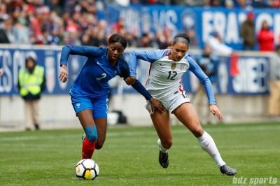 Team France defender Aissatou Tounkara (2) and Team USA forward Lynn Williams (12) battle for the ball