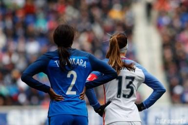 Team France defender Aissatou Tounkara (2) and Team USA forward Alex Morgan (13)