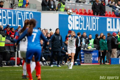 Team USA defender Kelley O'Hara (5) takes a thow in