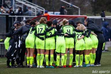 The Seattle Reign FC huddle before the start of the game
