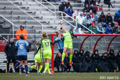 Seattle Reign FC defender Megan Oyster (4) heads the ball