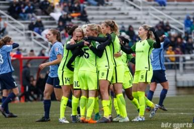 The Seattle Reign FC celebrate midfielder Megan Rapinoe's (15) penalty kick goal