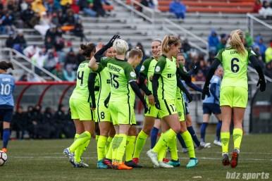 Seattle Reign FC forward Megan Rapinoe (15) celebrates her penalty kick goal with Seattle Reign FC defender Theresa Nielsen (8)
