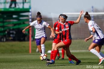 Orlando Pride midfielder Kristen Edmonds (12) and Washington Spirit forward Ashley Hatch (33)