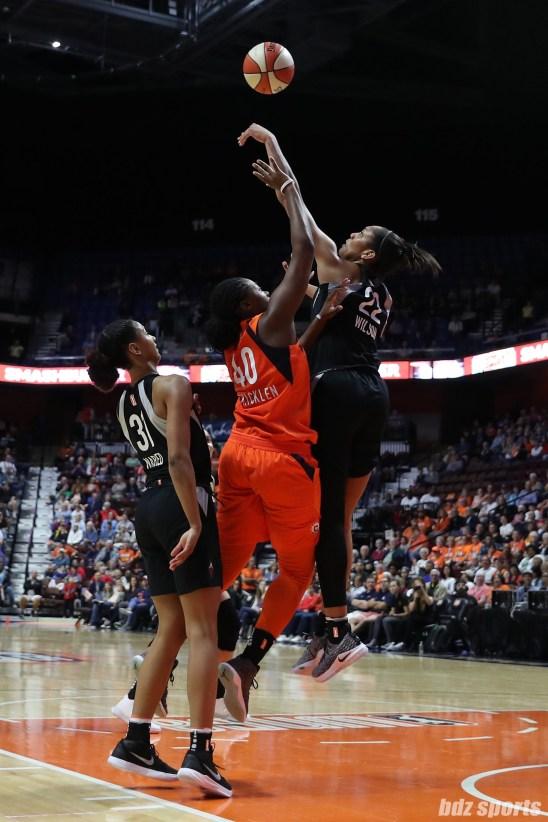 Las Vegas Aces center A'ja Wilson (22) and Connecticut Sun forward Shekinna Stricklen (40)