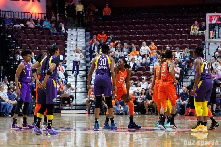 Los Angeles Sparks forward Nneka Ogwumike (30) takes the opening tip off against Connecticut Sun forward Chiney Ogwumike (13)