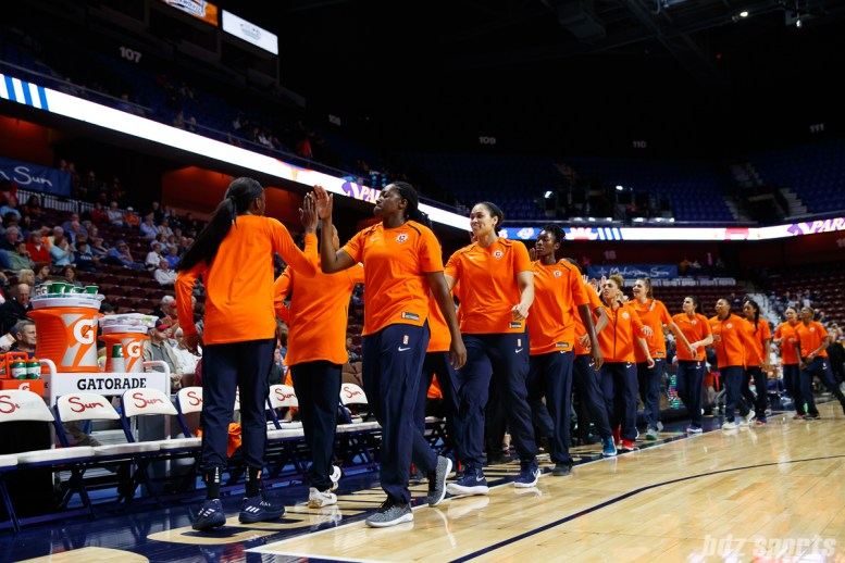 The Connecticut Sun high five before the start of their preseason game against the Los Angeles Sparks