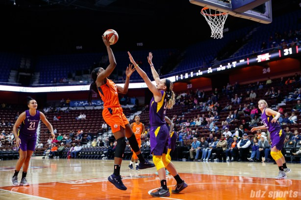 Connecticut Sun forward Chiney Ogwumike (13) and Los Angeles Sparks guard Sydney Weise (24)