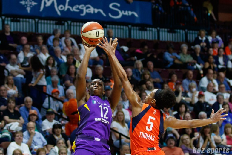 Los Angeles Sparks guard Chelsea Gray (12) and Connecticut Sun guard Jasmine Thomas (5)