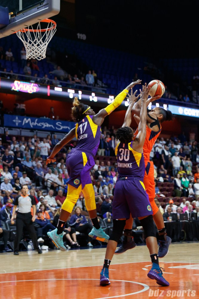 Connecticut Sun forward Alyssa Thomas (25) and Los Angeles Sparks forward Essence Carson (17)