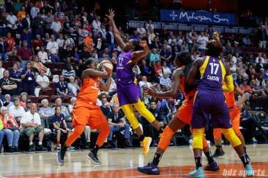 Connecticut Sun forward Shekinna Stricklen (40) and Los Angeles Sparks guard Chelsea Gray (12)
