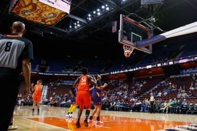 Connecticut Sun guard Rachel Banham's shot falls through the basket as time expires