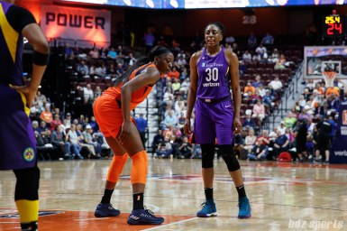 Los Angeles Sparks forward Nneka Ogwumike (30) and Connecticut Sun forward Chiney Ogwumike (13)