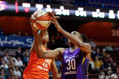 Los Angeles Sparks forward Nneka Ogwumike (30) and Connecticut Sun guard Courtney Williams (10)
