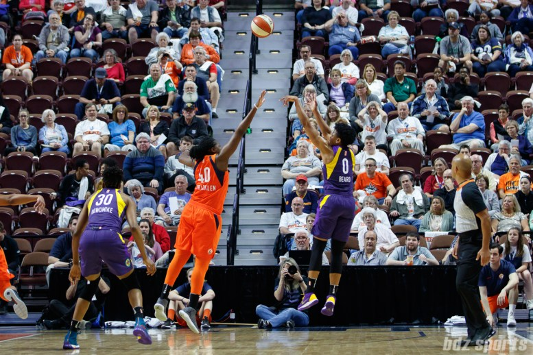 Los Angeles Sparks guard Alana Beard (0) and Connecticut Sun forward Shekinna Stricklen (40)
