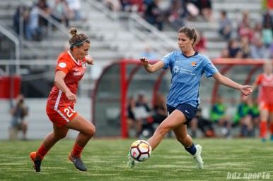 Houston Dash defender Amber Brooks (22) Sky Blue FC forward Katie Johnson (14)