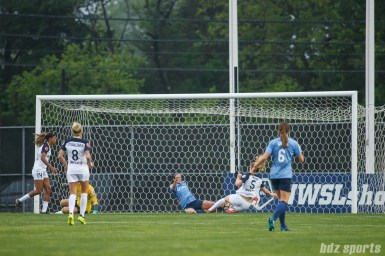 North Carolina Courage midfielder Samantha Mewis (5) slides on a loose ball to score Carolina's second goal of the game