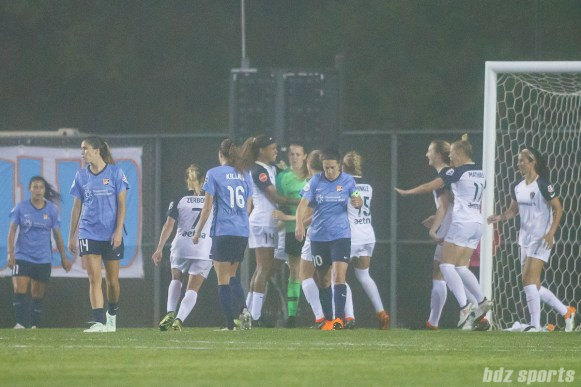The North Carolina Courage congratulate goalie Katelyn Rowland (0) after her double save - stopping both a penalty kick and rebound shot