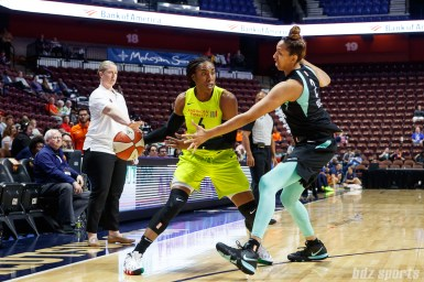 Dallas Wings Kayla Thornton (6) and New York Liberty center Mercedes Russell (2)