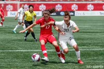 Team Canada midfielder Jessie Fleming (17) and Team Germany midfielder Lina Magull (20)