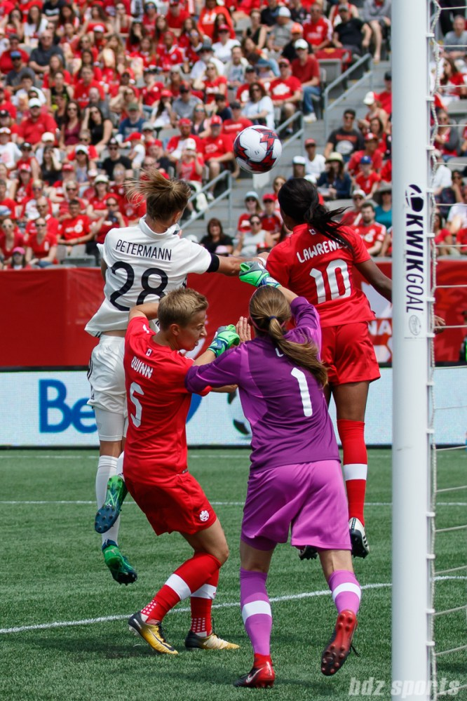 Team Germany forward Lena Petermann (28) and Team Canada midfielder Ashley Lawrence (10)