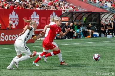 Team Canada midfielder Sophie Schmidt (13)