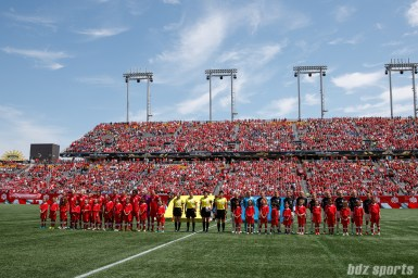 Team Canada and Team Germany starting XI before the start of their international friendly game at Tim Horton's Field in Hamilton, Ontario on June 10, 2018