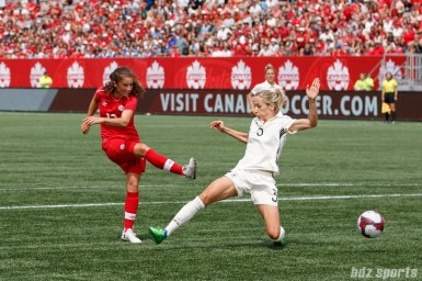 Team Canada midfielder Jessie Fleming (17) beats the German defense to score Canada's second goal of the game